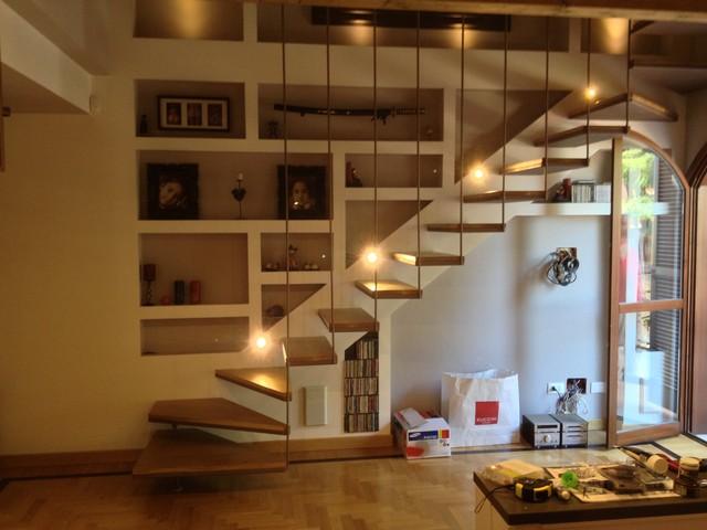 Scale in legno su misura rivestimento di scalini in - Scale per librerie ...